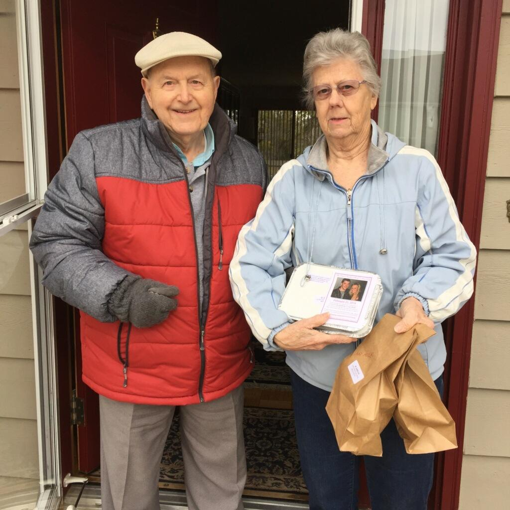 Meals on wheels client and volunteer